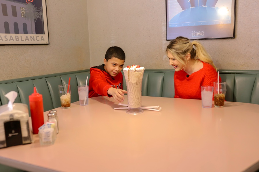 Picture of Ben and Sherae sitting at table with shake in front