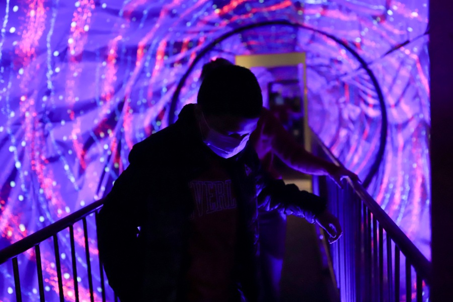 Picture of ben in purple tunnel at illusion museum.