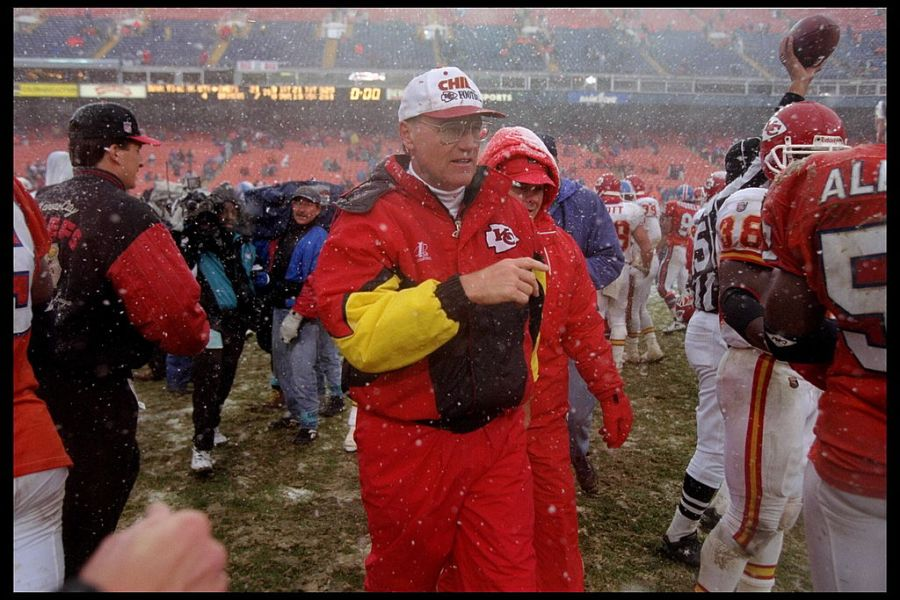 Picture of Marty Schottenheimer walking in snow after win at Denver Broncos