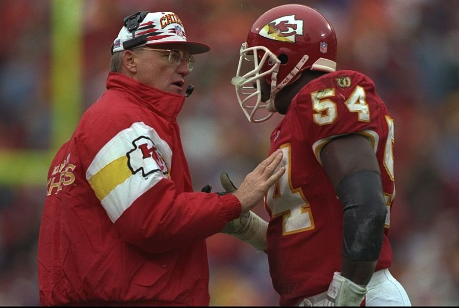 Marty Schottenheimer talking to #54 picture