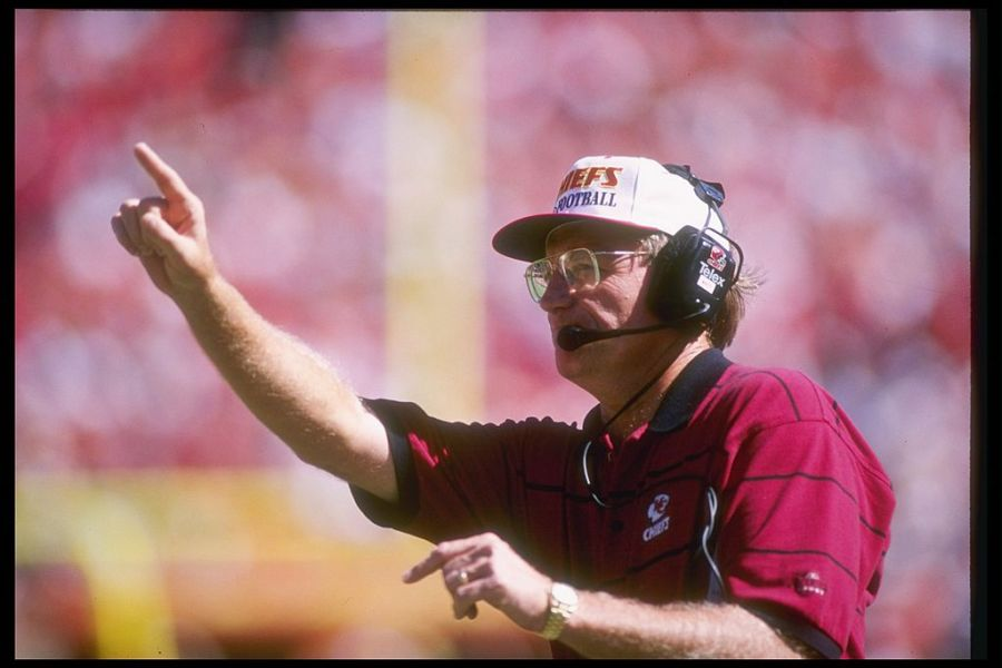 Picture of Marty Schottenheimer holding up index finger