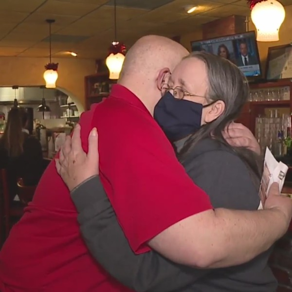 Picture of Brenda and Greg hugging at the restaurant