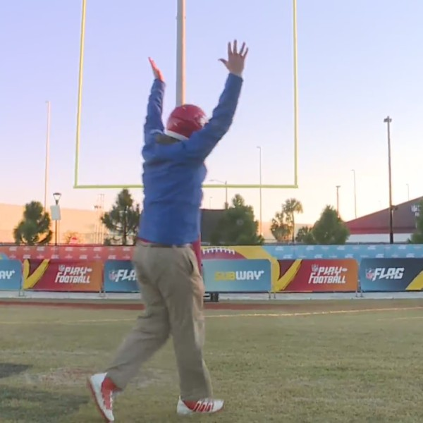 Picture of Pat raising both his hands after making field goal