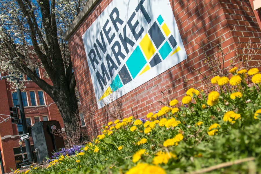 Picture of flowers around River Market sign