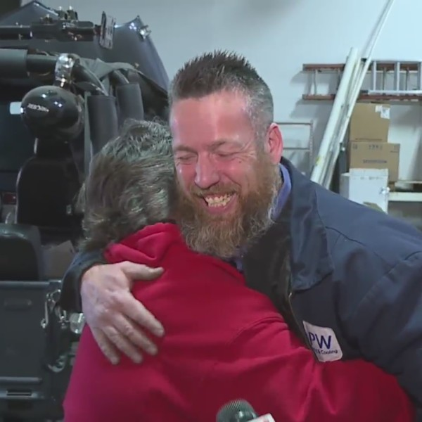 Picture of technition hugging woman for pay it forward