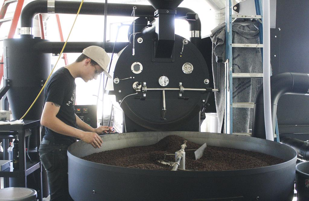 Picture of worker roasting beans at Messenger