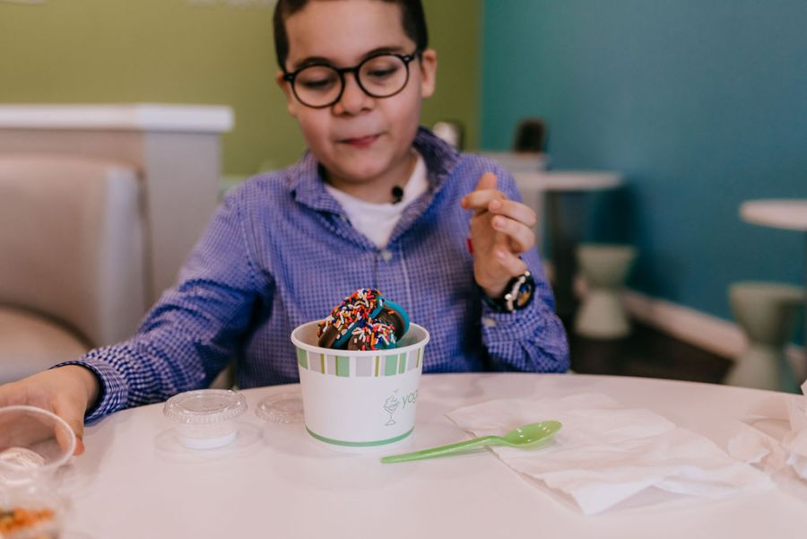 Picture of Jovani digging into cotton candy and cookies n' cream.
