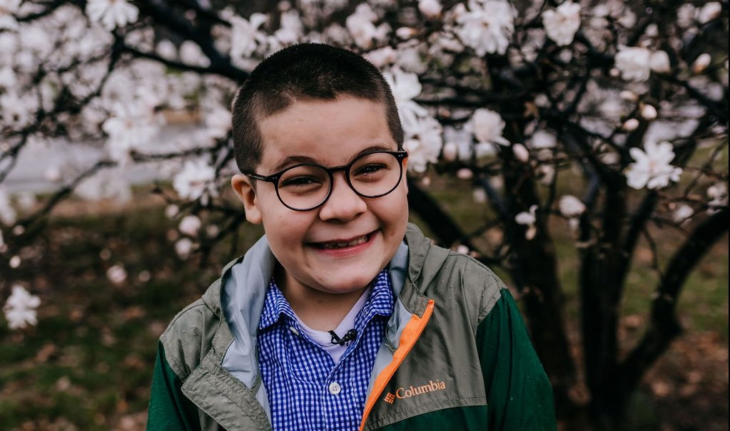Picture of Jovani smiling. Photo Credit: Rebecca Lassiter Photography