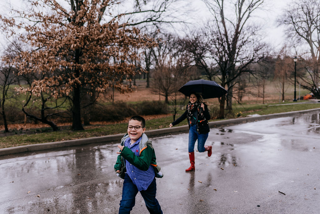 Picture of Jovani and Sherae running in the rain.