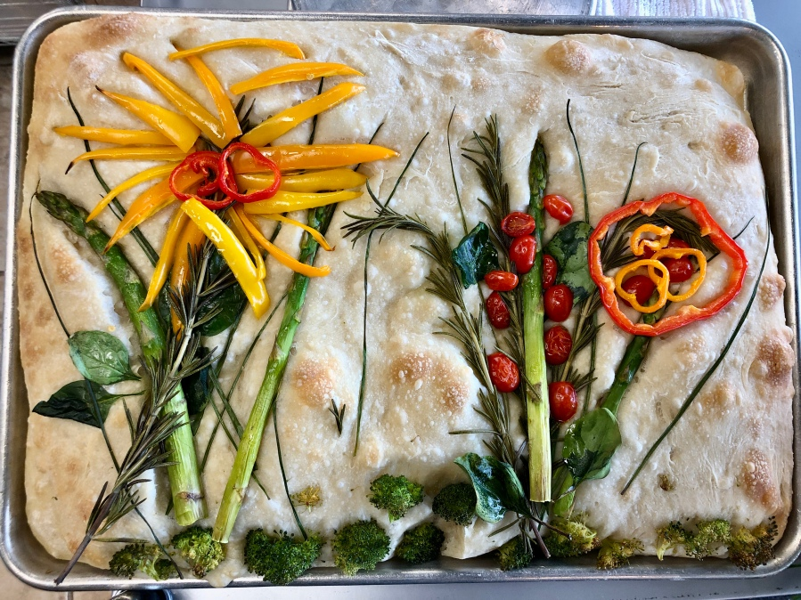 Picture of focaccia decorated with vegetable flowers