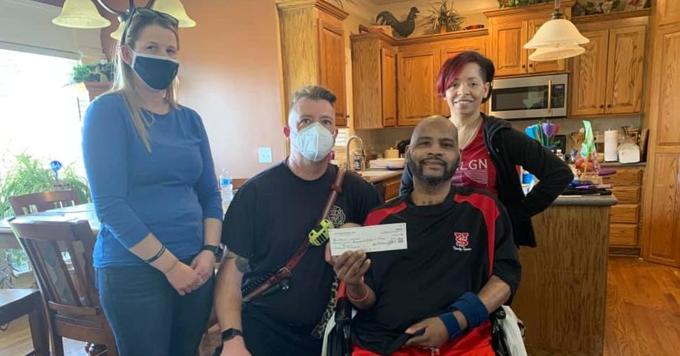 Picture of Morris Letcher holding check