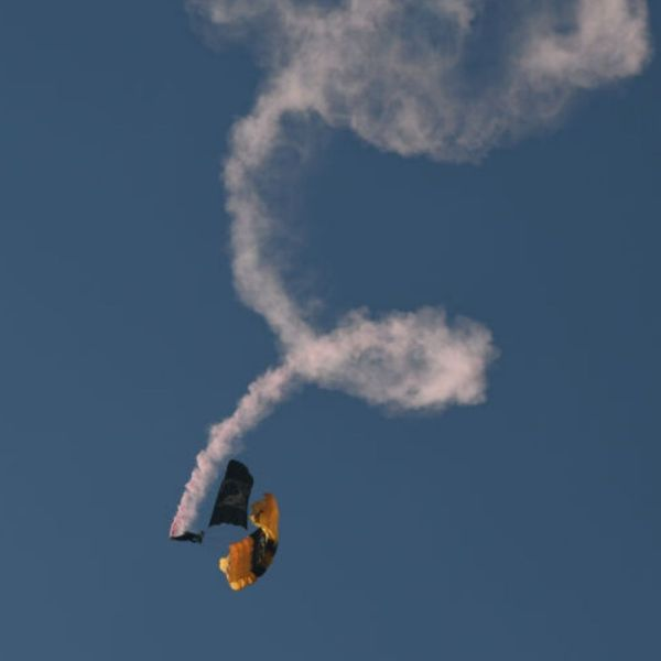 Picture of parachuter with smoke trails