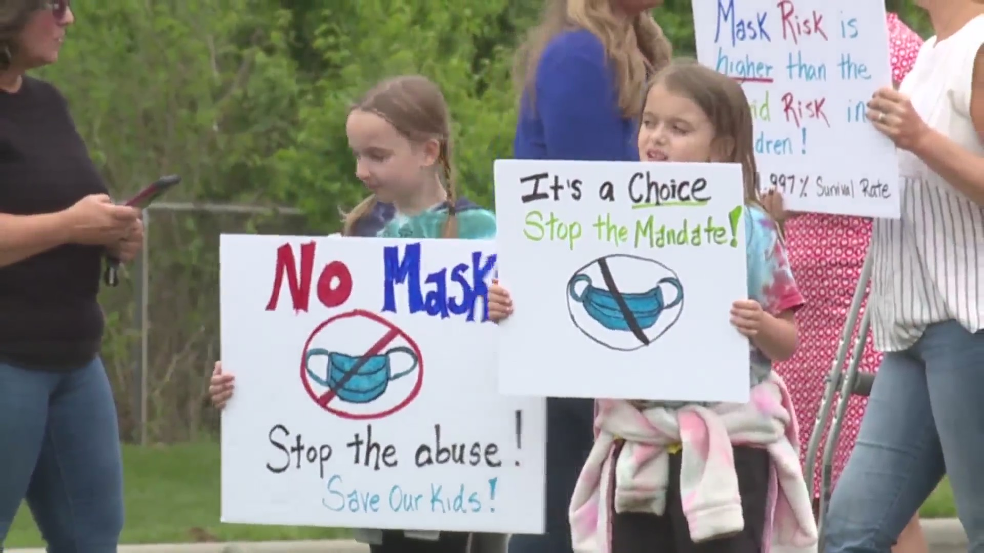 Picture of Shawnee Mission students holding anti-mask signs