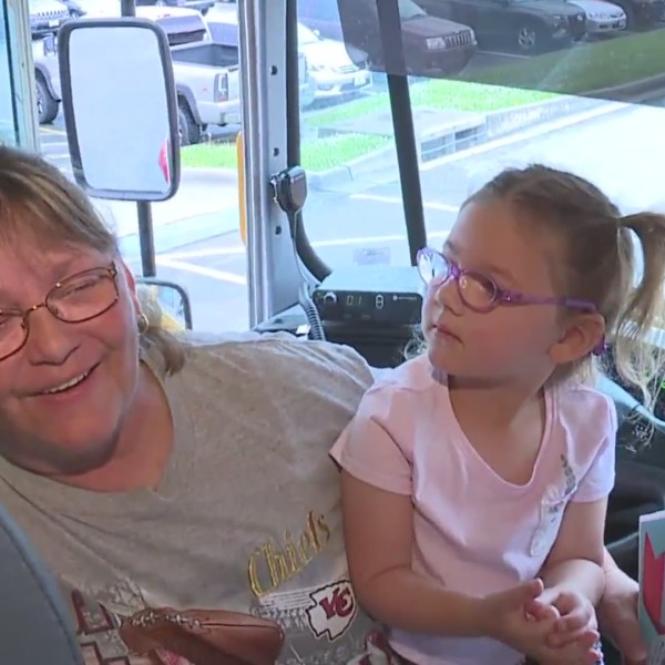Picture of bus driver smiling with kindergarten students