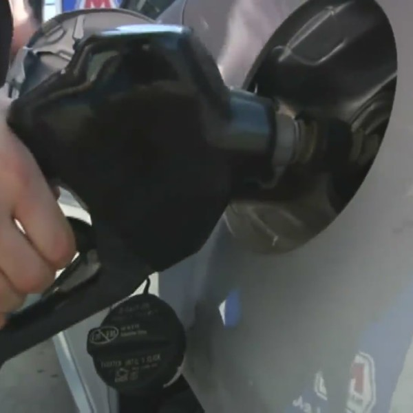 Picture of person filling up vehicle with gas