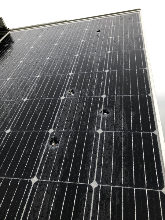 Picture of solar panel with bullet holes