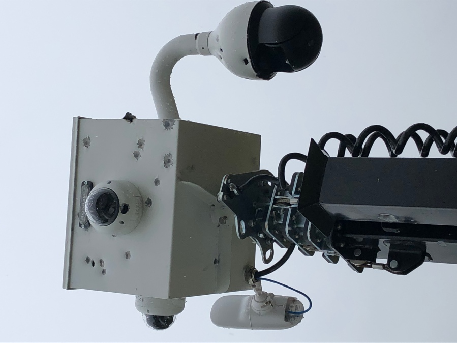 Picture of security camera with bullet holes
