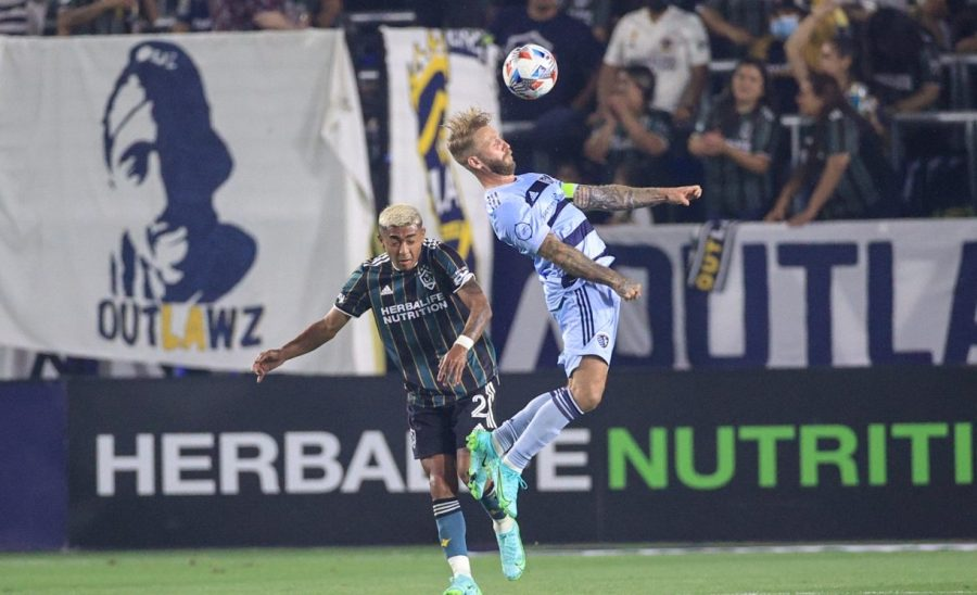 Picture of Johnny Russell heading the ball