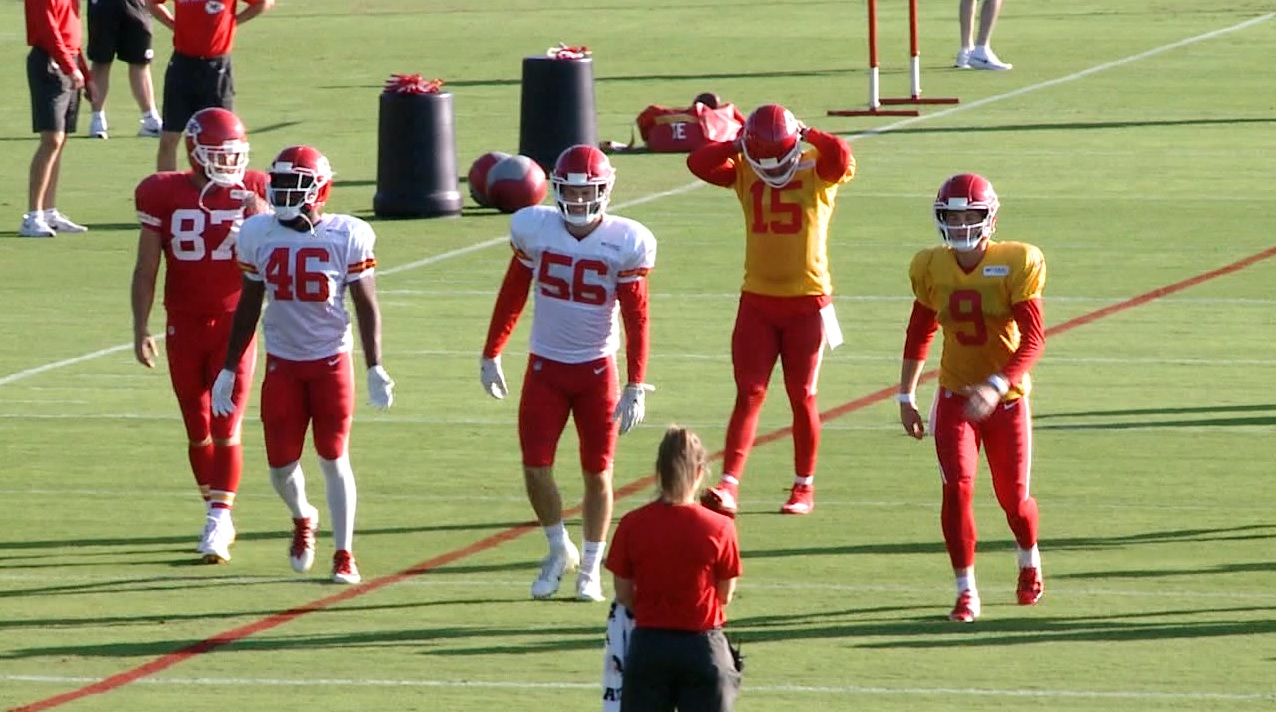 Chiefs players warm up at training camp